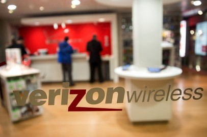 The Verizon Wireless logo is displayed on a window at a retail store in Washington, D.C., U.S., on Thursday, Oct. 23, 2014.