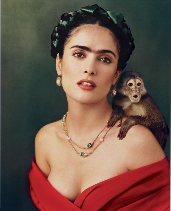 Salma Hayek alongside with the monkey who attacked her years ago.