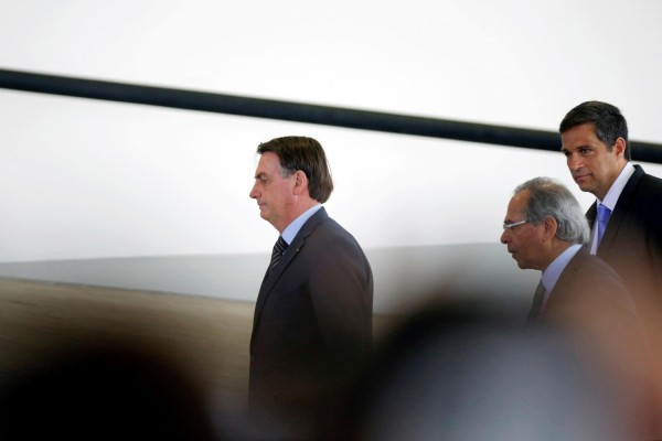 Brazil's President Jair Bolsonaro, Brazil's Economy Minister Paulo Guedes and Brazil's Central Bank President Roberto Campos Neto arrive for a launch ceremony at the Planalto Palace in Brasilia
