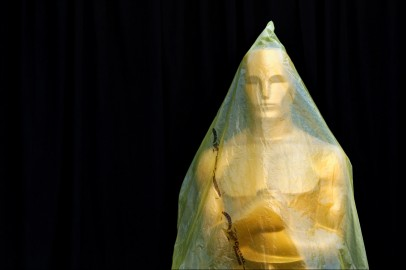 An Oscar statue stands covered with plastic during preparations leading up to the 87th Academy Awards in Hollywood, California