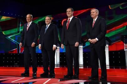 Republican presidential candidates (L-R) George Pataki, Mike Huckabee, Rick Santorum and Sen. Lindsey Graham (R-SC)