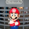 The logo of Japanese gaming giant Nintendo and its game character Super Mario are displayed at a showroom in Tokyo on September 8, 2016.