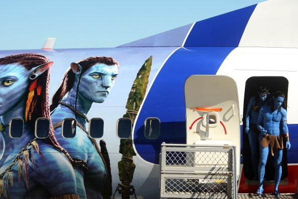 Models dressed up as characters from the film 'Avatar' depart an Avatar branded plane during the launch of 'AVATAR' Blu-ray and DVD at Sydney Domestic Airport on April 29, 2010 in Sydney, Australia.