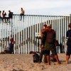Migrants, part of a caravan of thousands trying to reach the U.S., gather at the border fence between Mexico and the United States after arriving in Tijuana, Mexico November 13, 2018.