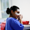 A nurse removes plasters from her face at the end of her shift inside the intensive care unit where patients with (COVID-19) are treated at Juarez hospital in Mexico City