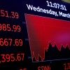 A board at the New York Stock Exchange shows state of the market as markets continue to react to the coronavirus disease (COVID-19) inside of the NYSE in New York