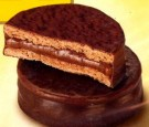 """Alfajores are customary Latin American delicacies typically coming in a pair of soft cookies around """"dulce de leche"""" covered with chocolate."""