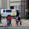 CBP agents look at migrants who crossed illegally into El Paso, Texas, U.S. to turn themselves in to ask for asylum as seen from Ciudad Juarez
