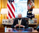 President Biden Signs PPP Extension In Oval Office