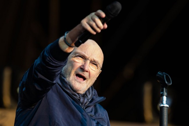 Frail-Looking Phil Collins Sings From His Chair as the Genesis Farewell Tour Kicks off in Birmingham