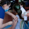 Child gets COVID vaccines