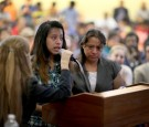 FORT LAUDERDALE, FL - AUGUST 13: Elva Arely Chavez Puac, 16 years old and originally from Guatemala, (L) stand with her mother Micla Puac as she speaks during an Immigration Field Hearing held by U.S. Rep Joe Garcia (D-FL) and Rep. Ted Deutch (D-FL) at Br