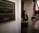 Reporters interview an undocumented immigrant outside the locked offices of Speaker John Boehner (R-OH) with other members from the immigrant youth-led organization United We Dream as they demonstrate against lawmakers who do not support an end to deporta