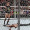 Randy Orton standing over WWE World Heavyweight Champion Seth Rollins.