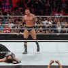 Randy Orton standing tall after delivering an RKO on Roman Reigns on