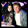 Bruce posing with daughter Kylie Jenner