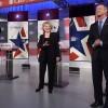 Democratic Presidential hopeful Hillary Clinton (C) and Bernie Sanders (L) wave and Martin O'Malley