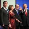 Republican presidential candidates (L-R) Rick Santorum, Carly Fiorina, Mike Huckabee and Jim Gilmore pose for photographers prior to the Fox News - Google GOP Debate January 28, 2016 at the Iowa Events Center in Des Moines, Iowa. Residents of Iowa will vo