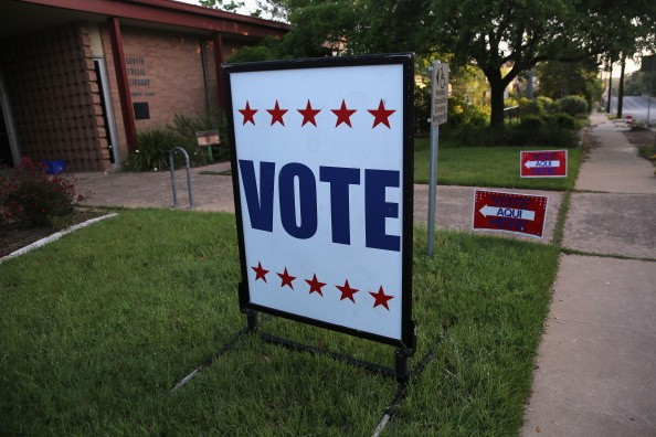 English-Spanish Signs Front Election Center In Texas